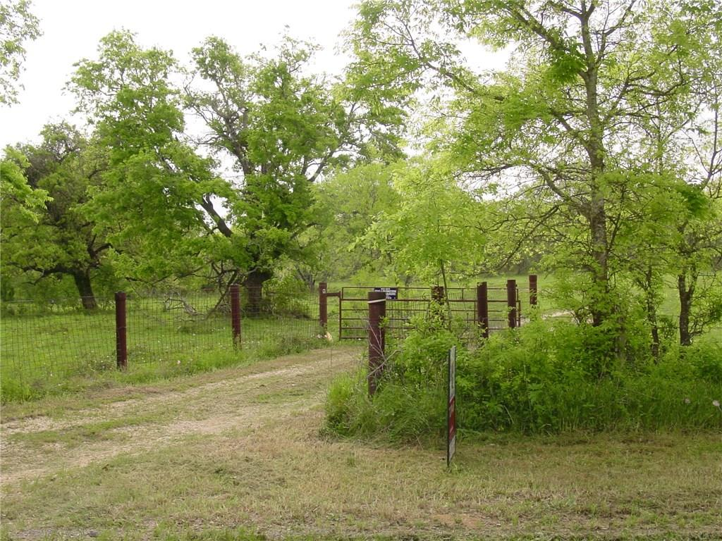 Looking for ranch land that is heavily wooded and has a pond on it and all fenced in. Affordable and all level with mesquite and Oak Trees! Deer abundantly! Some open spots and can drive on most with John Deere! Great for hunting and raising cattle and will make a great gentleman's ranch. In between Seguin and Stockdale in a very remote location.