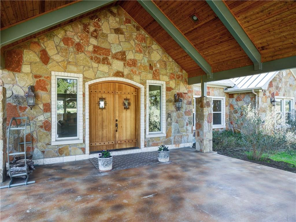 63 unrestricted acres, majestic oaks, hill country views, two ponds & wide, open native grass pastures. Beautiful 4/2 home w/ updated finishes & fieldstone construction on 4 sides; wood burning fireplace; patio setting complete w/ in-ground pool & BBQ area. Includes original 1950's farm home guest house w/ 40x60 metal shop & additional sheds on either side. Under wildlife tax status w/ nature hiking paths. Bring your family, horses, livestock, and dreams to this one-of-a-kind property that has it all!Guest Accommodations: Yes  Pool Desc: Perimeter Fence