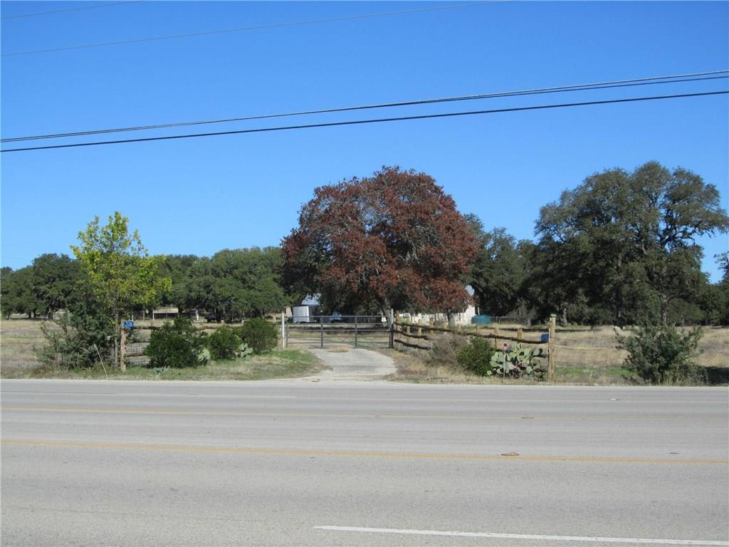 Robinson Ranch, 13.127 acres on W. US Hwy 290 in the fast growing Dripping Springs/Hays County area.  Part of an old family ranch with 300.29 ft. of hwy frontage.  Mature oaks on gently sloping hill country land. Great potential investment/commercial property located across from 2 new subdivisions with commercial properties in the area.  Includes a ranch house with rental income or office space potential.  Partially fenced with a small barn and outbuildings.  Horse and animal friendly. Ag tax exemption.