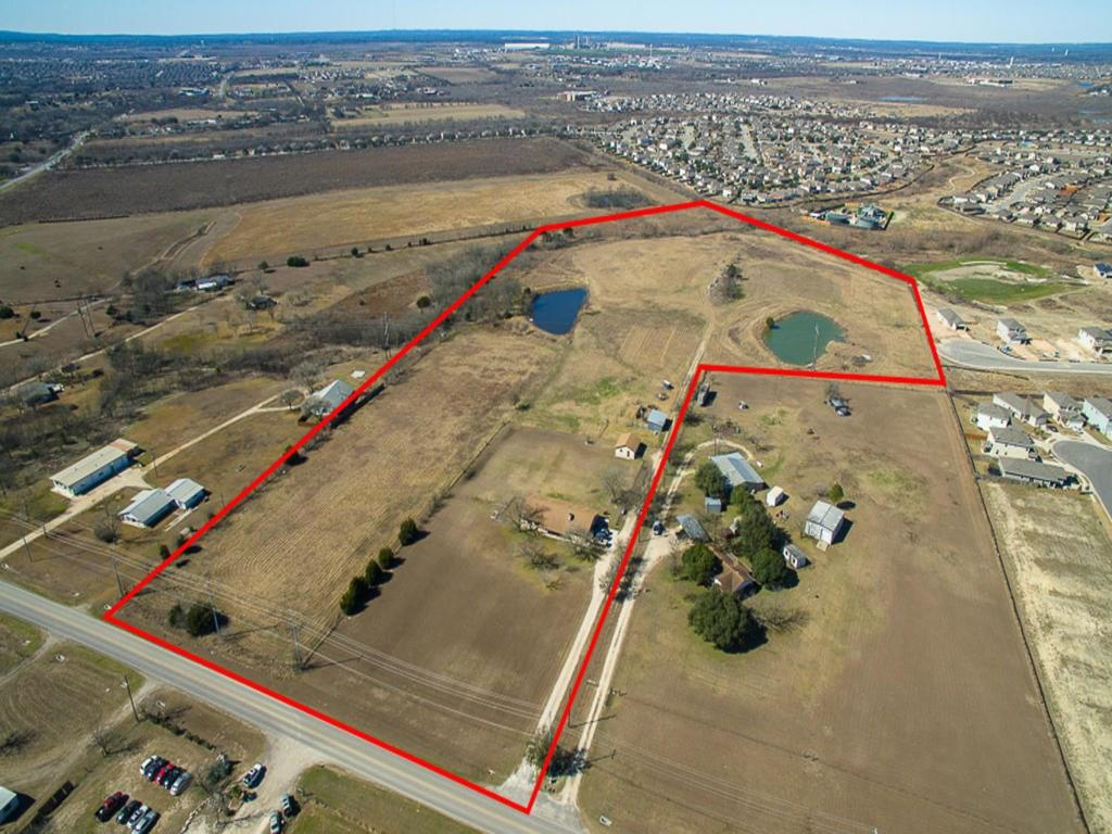 25+ acres off Windy Hill Rd, short drive to I-35 and commute to Austin or minutes from shopping and entertainment in Buda and Kyle. Great recreational property, raise livestock and or subdivide. Well maintained house with tasteful updates, original owners.