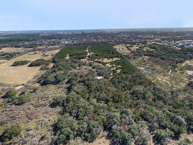Rare Opportunity to own a heavily treed parcel with a pond and views to forever (well, kinda) at the end of a country road that is just outside the City of San Marcos city limits and adjoins the Ringtail Nature Preserve.  Ranch Road 12 runs parallel with Eastwood Ln.  A private county road that is only a minute from the intersection of Craddock and Old RR12. An adjoining 12.36 Ac. parcel can also be purchased yielding just over 50 Ac with approx 600 feet of road frontage.