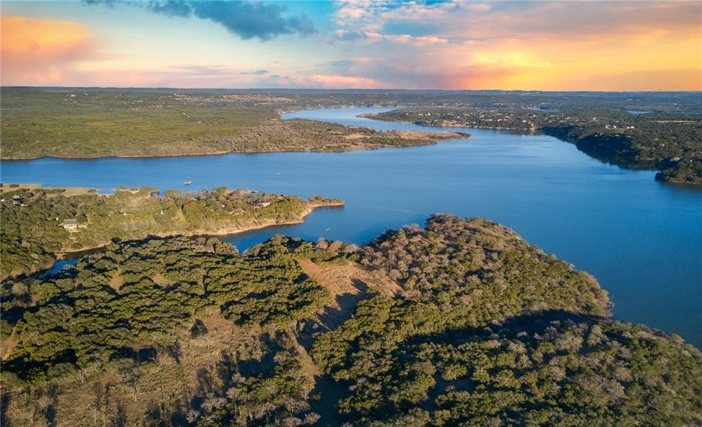 Rare opportunity! Over 50 acres/Point Lago, spectacular waterfront acres on the main body of Lake Travis. Perfect ranch or divide into as many as 42 lots, 3 sided waterfront estate. Private stone entrance, panoramic views, large oak trees scattered among the heavily wooded property while surrounded by picturesque views.   Great location just within minutes of HWY 71, schools, shopping, restaurants and more!Restrictions: Unknown