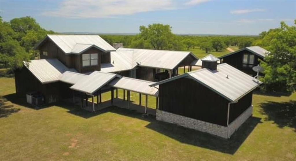 manicured gentleman ranch on SH 71 approx 8 miles West of LLano. 3/4 mile of hwy frontage, 2 story ranch style home includes 3 bed & 3.5 bath, office suite and studio apartment w/ covered walkways / 2 car garage. Amenities include a climate controlled 7 horse stall barn,grooming stall,tack room,feed storage & stock pens. Huge climate controlled maintenance barn,2 wet weathered tanks,covered shooting range,90 ac of high game fence,60 ac hay field,wet-weather Johnson Crk. PRICED UNDER APPRAISAL!Restrictions: Unknown
