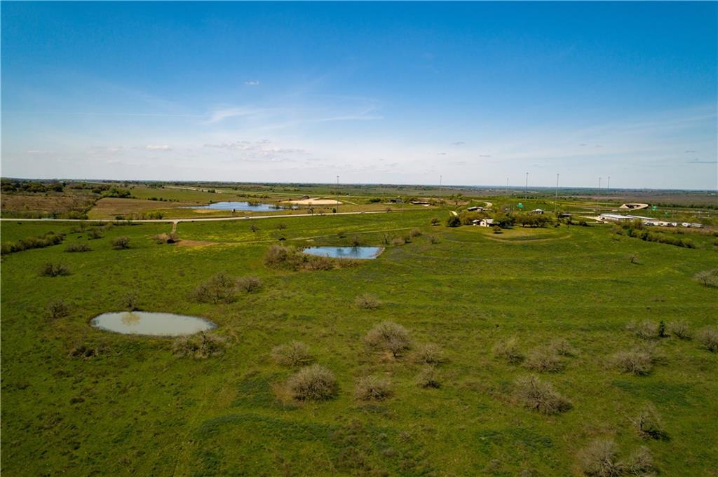 This property has extraordinary visibility and is in the immediate growth path of Lockhart and growth coming out of Austin. It is well suited for an investment property or a development tract. Approximately 2,000 ft of Highway 183 frontage just south of the convergence of SH 130 and Highway 183. The property is comprised of a hilltop at the Highway 183 frontage overlooking fields which were once cultivated and features 3 ponds. Plum Creek meanders through the property for over 1.3 miles.Restrictions: Unknown