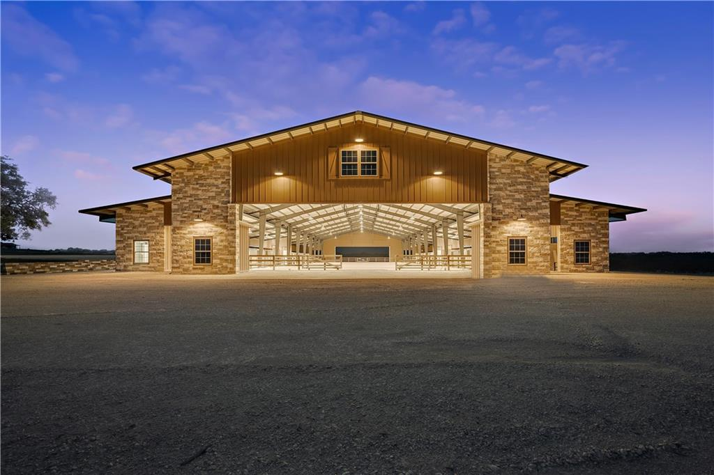 Elegantly designed 90.51 acre equestrian property minutes from Johnson City, TX. Covered arena including stalls 130 x 260 under roof. Riding arena inside is 80 x 240. Facility was built to perfection including 24  (12x12) stalls equipped w/ hay & grain feeders. 4 wash racks w/hot & cold water on each side of arena. Amenities include tack & feed rooms,office,bathroom & lounge. LED lighting in arena. Well & Septic, 2 ponds new interior roads, additional hay barn 20 x 130 with 50 x 75 covered area..FEMA - Unknown