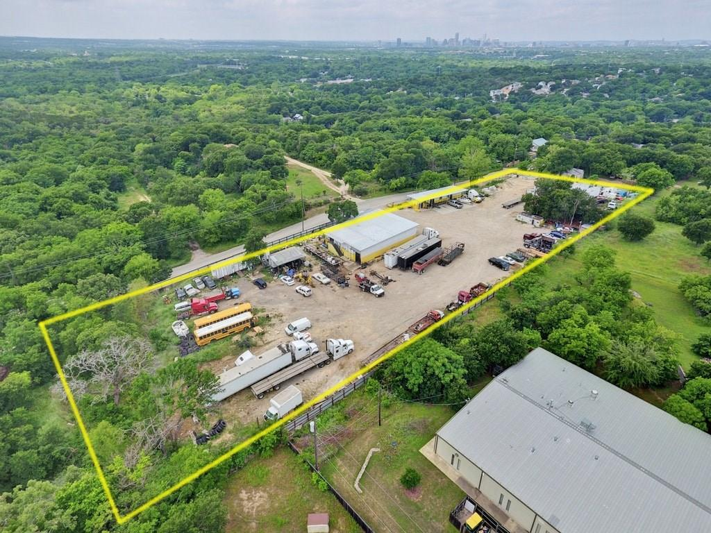Incredible Opportunity in East Austin! Rare 2.61 acre lot in the BOOMING 78721 zip code. Seconds away from the new Hwy 183 South Project which is projected to be completed in 2019 (Phase 1). Endless Potential! Zoned CS-MU-CO-NP. Site would be perfect for Single and Multi Unit Family Housing, Storage Facilities, or a buy & hold opportunity.Great Downtown / Skyline views with elevation. Minutes from Downtown Austin and Bergstrom Airport.Endless Possibilities. Approved Site Plan in process & coming soon.Restrictions: Yes
