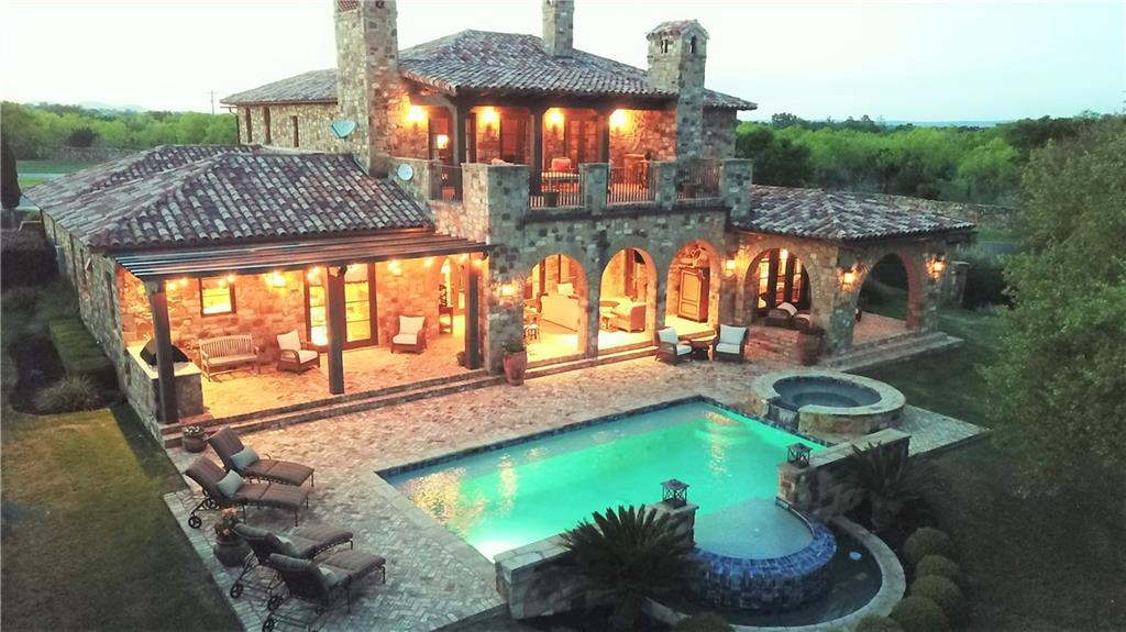 Extraordinary Tuscan inspired furnished 4 bedroom 4.5 bath home inside the private gates of Escondido Golf and Lake Club--Equity Golf Membership  conveys--