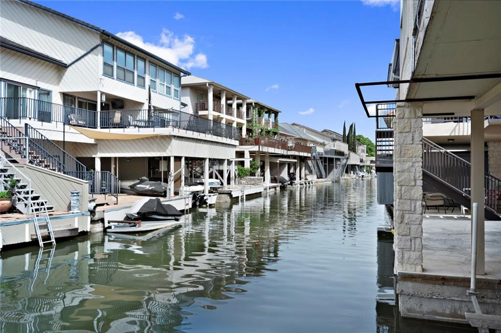 NEW PAINT, Complete Interior! This waterfront 3BD/3.5BA dream home features seamless indoor-outdoor living space and a private dock on a peaceful channel right off Lake LBJ. Over-sized great room with fireplace, and open chef's kitchen. Three complete bedroom suites, including luxurious master with spa-like en suite bathroom. Convenient powder room and large laundry room/mudroom. Attached two-car garage and two covered boat lifts. Horseshoe Bay Resort amenities and golf courses just 50 miles from Austin.Restrictions: Yes