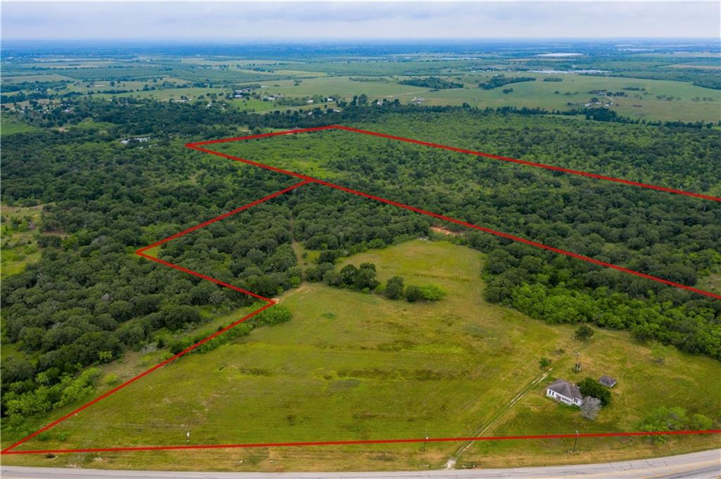 Investor/Developer potential! 60 +/- ac within 2 mi of the city limits of Gonzales! Ag exempt, native grasses & wildlife areas. Open area apprx 10 acres & scattered hardwoods, wet weather creek. Centrally located commuting with only 7 mi to I-10, 45 min-Austin airport, 1 hr-San Antonio, 2 hrs-Houston & 2 hrs-Texas coast. City water & co-op elec avail. Fence on back side of property, partial fences on sides. Primitive farm house &storage shed. Lots of State Highway road frontage.Restrictions: Unknown