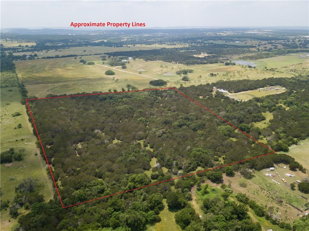 ALL NATURAL/WOODED AG-EXEMPT ACREAGE IN BURNET COUNTY ~ Very Private! ~ No Restrictions ~ Fenced on 3 Sides ~ Invisible Access Easement ~ Driveway Needed ~ Hard Wood Trees & Cedar ~ Dry Creek ~ Super Low Tax Rate & Ag Exempt ~ SHOWN WITH APPOINTMENT ONLY!