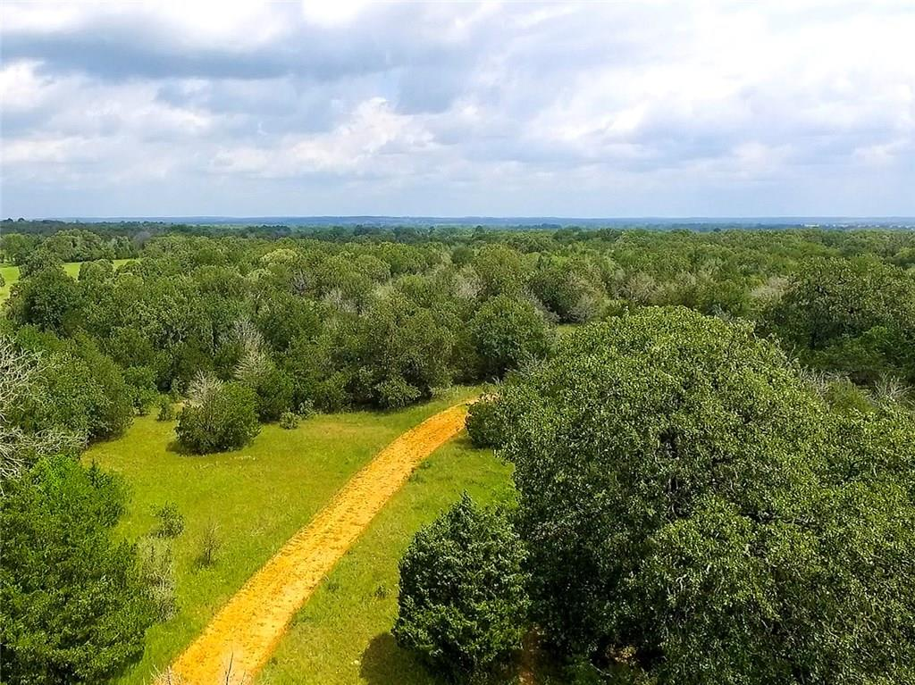 "This amazing Texas ranch land has been in the same family since 1895. Roughly 1.3 miles long and 0.4 miles wide at the widest point. Live creeks, 3 ponds (one spring fed), several pastures, large mature oaks, wooded and open areas, abundance of wildlife. Currently a working ranch for cattle. Almost unheard of in this area: owners are conveying 100% of the minerals! Be sure to download the ""Features"" document and check out the property video. If you watch the video then you have seen the property.Restrictions: Unknown"