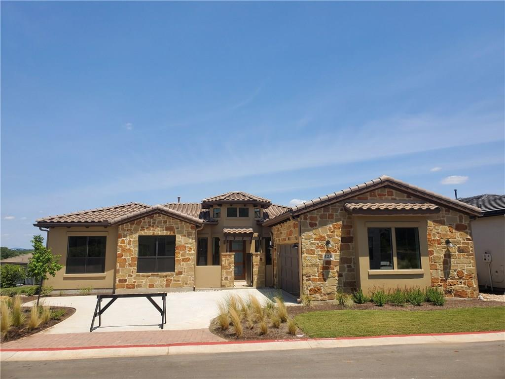 This entertainers home features 3 bedrooms,large dining room, over sized island, walk-in pantry, office & 2 baths in Tuscan Village 55+ community in Horseshoe Bay. Full lawn maintenance. The features in this open floor plan include wood flooring in main living area, stone fireplace, granite counters, Bosch stainless appliances w/gas cook top. Construction on the clubhouse & pool are underway! Dog park, community garden & walking trails are coming soon too! Includes 1 year prepaid HOA dues.Restrictions: Yes  Sprinkler Sys:Yes