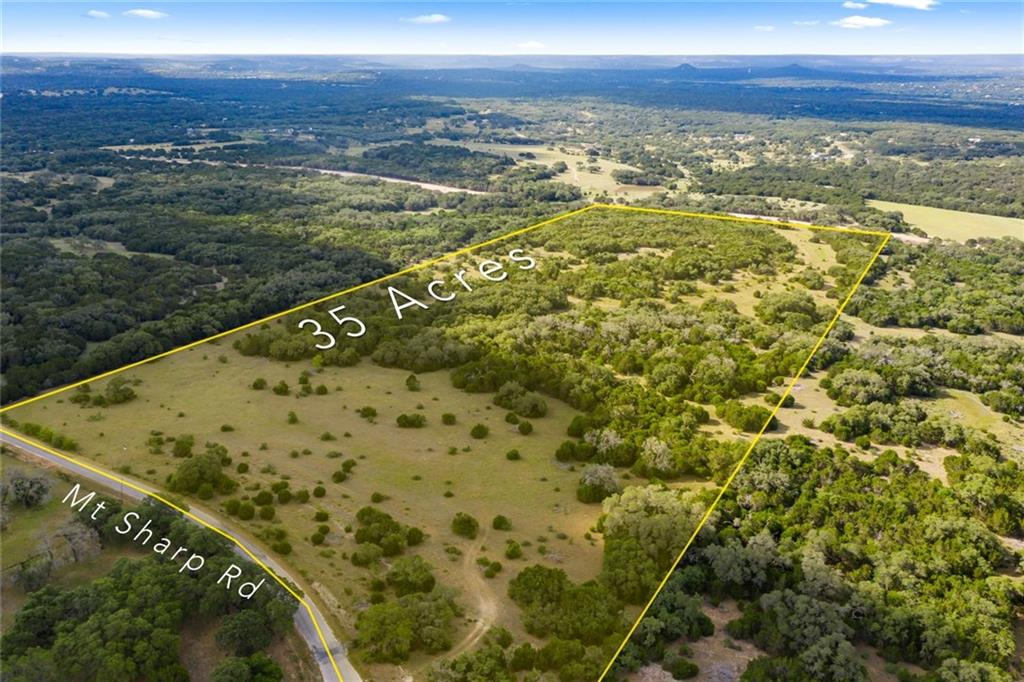 +/- 35 acres located in the beautiful Texas Hill Country covered with mature trees.  Property fronts Mt. Sharp Rd and is fenced on three sides. Ten minutes from shopping in downtown Wimberley. Perfect for horses, cows, goats or any other livestock to make this your own little ranch. Property has wildlife, suitable for hunting and a wet weather creek.Restrictions: Yes