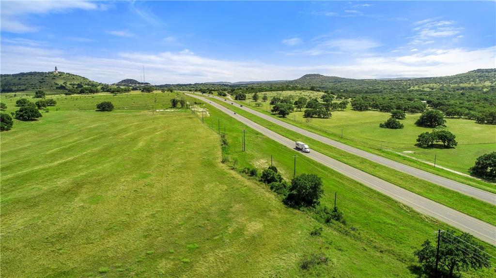 12+/- Acres w/1100 ft of frontage on US Hwy 281, property is located less than half mile of Johnson City, TX. Phenomenal site for any kind of Commercial/Retail along w/many other potential uses. Traffic count at this location is between 10,097 & 12,935 cars/per day. Power is already at the property. City water is very close to the property. All owned mineral rights will convey to Buyer. A prime piece of property located in one of the fastest growing areas in the USA. Priced at $1.60 per SF.Restrictions: Unknown