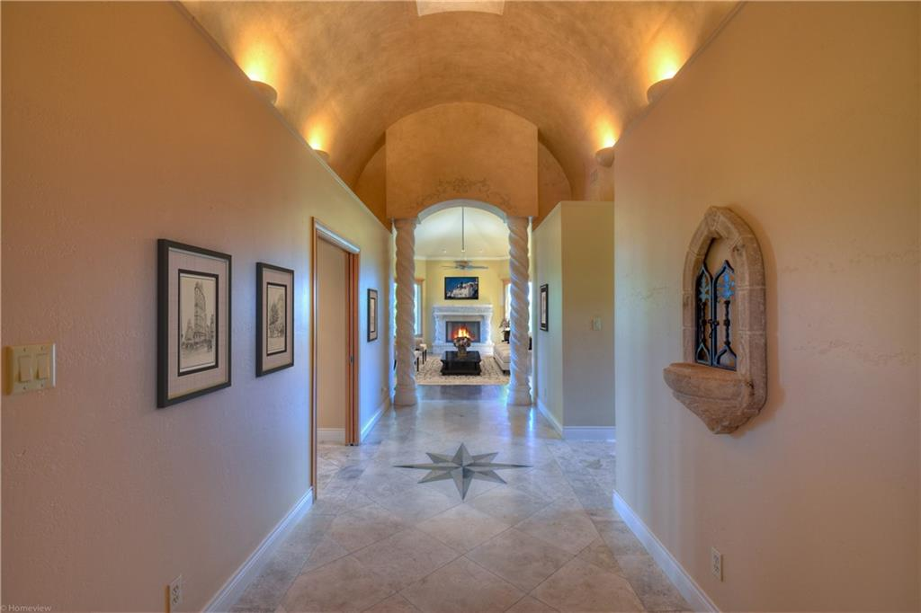 Beautiful, single-story custom home! Spacious foyer. Spectacular hallway with a lit barrel ceiling. LARGE WINDOWS in living room, dining room, & family room. 2 fireplaces with gas starters. Lake and golf course views. More features: wet bar with ice maker, HUGE walk-in pantry, gas cooktop, double ovens, warming drawer, commercial size refrigerator/freezer, breakfast bar, granite counters, powder bathroom, large office, laundry room with sink. Split bedroom floor plan; each bedroom has private bathroom.Restrictions: Yes