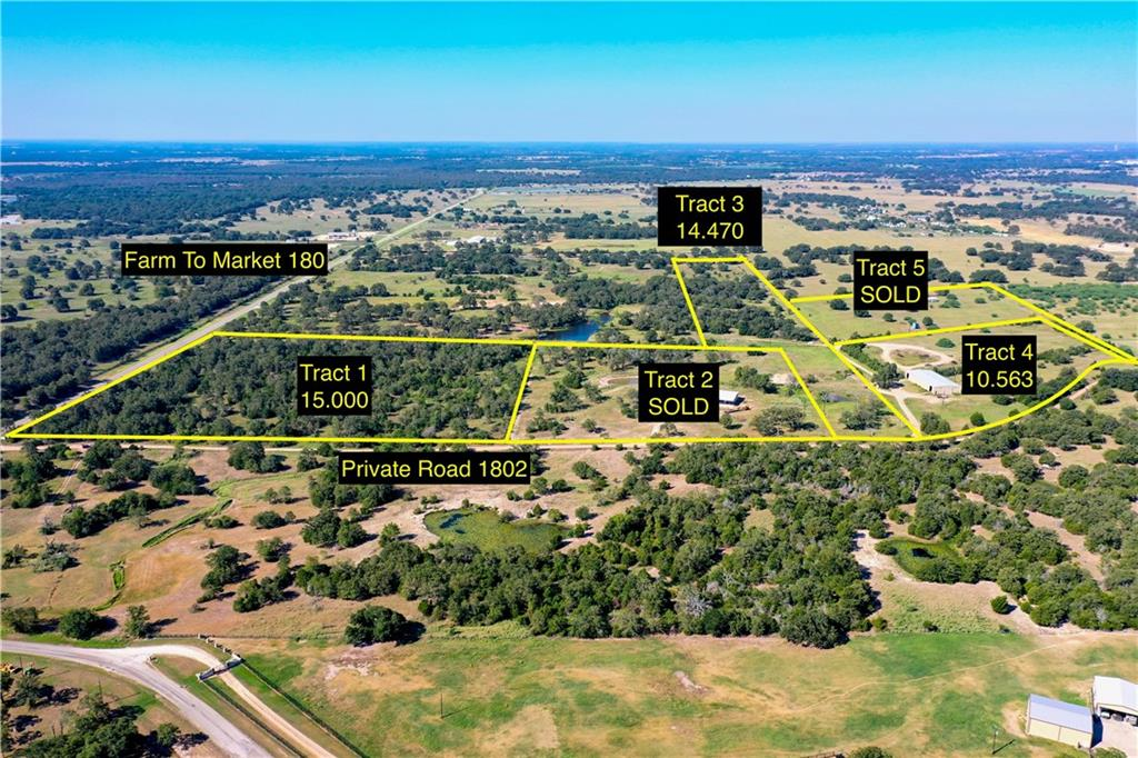 Centrally located between Houston and Austin! Property has large metal multi-purpose building, water, fencing and electric already on property.  Old septic on property of unknown condition and assumed non-functioning.  Two addiitonal tracts are available, see photo for details.  Restricted against mobile home parks. This listing is only for the area labeled as TRACT 4.  (The drone video shows multpile tracts.)Restrictions: Unknown