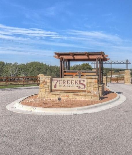 Elevated views of 7 Creeks Lake and the surrounding Hill Country make lot 102 an ideal spot for your home! 9 miles form Burnet & 45 miles from Round Rock, 7 Creeks Ranch is close to the city but with the privacy of country life. Amenities: 18-acre community park with fishing lake, picnic pavilion, fire-pit & grill. Private paved roads, electricity & high-speed internet service in place. Out-of-sight cabins & barns allowed.  There's no deadline to build, so claim your piece of the Hill Country today.Restrictions: Unknown Comm. Features: Health Club Discount
