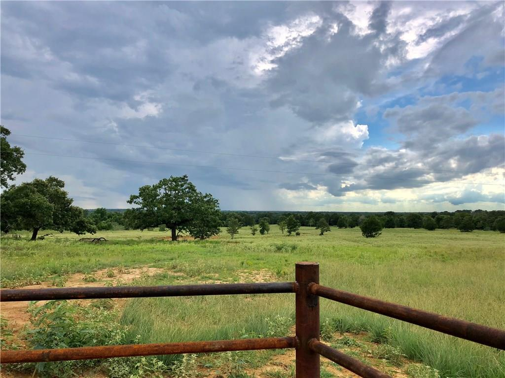 21+ acres: Nice westward view, pond, & utilities. Partially wooded, large pond, mature oak & cedar trees, a pipe entrance w/cattle guard, barbed wire fencing. Wildlife includes deer, wild hogs, & more. Sandy top soil, with clay. Seller will upgrade pond with reasonable offer. Serviced by Aqua Water Supply & Bluebonnet Electric. Water meter box from the prior owner onsite. Electricity crosses the property near the front. Septic needed.