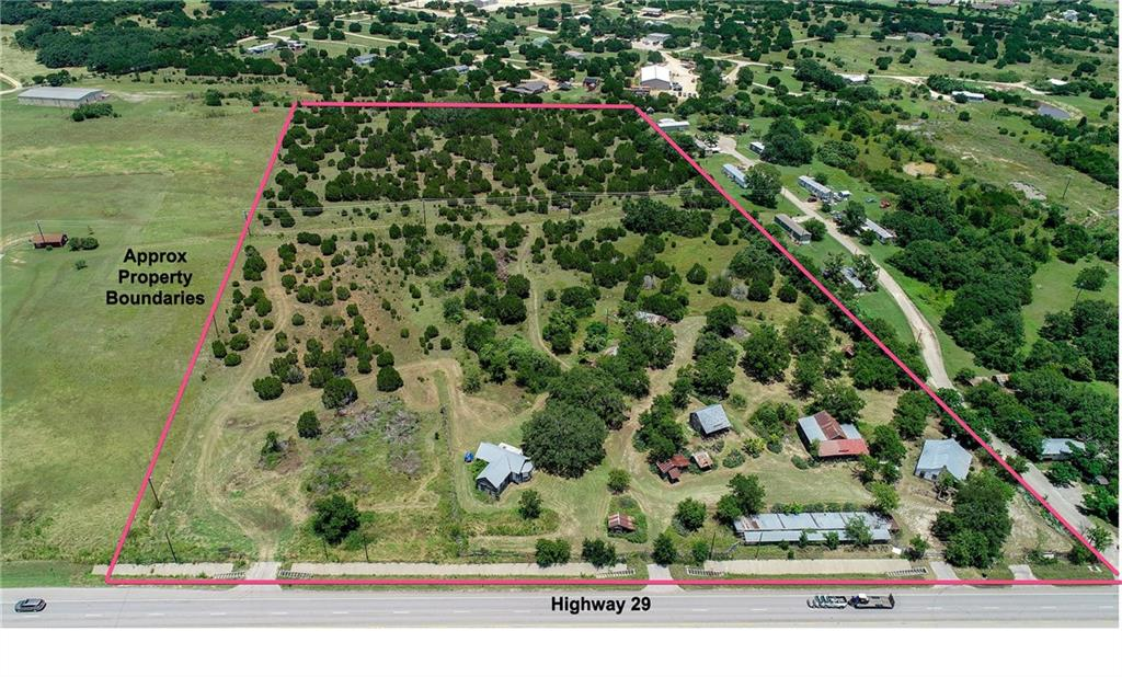 16 acres of land with 675' of Highway 29 frontage in Liberty Hill, all utilities present. Ft Tumbleweed is a collection of historically significant buildings the current owner spent 40 yrs assembling. The buildings only occupy 3-4 acres with the majority of the land primed for redevelopment. This would be an ideal location for a brewery, winery, distillery, live music venue, wedding venue, or entertainment destination where the structures would be preserved/rehabbed in the front with new buildings behind.Restrictions: Yes