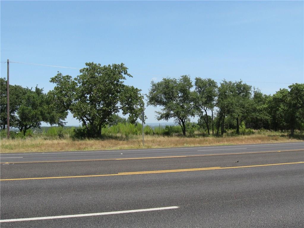 Restrictions: Yes Big Price Reduction! Great 3 Ac commercial lot with over 250 ft of Hwy 71W frontage near the entrance of Travis Settlement. Level building site with panoramic views of Lake Travis and the Hill Country. Excellent Hwy access and visibility. Multiple uses - office, retail, warehouse, storage, etc. Near Sweetwater Ranch and West Cypress Hills in the fast-growing Hwy 71W corridor. LTISD  Motivated Seller!