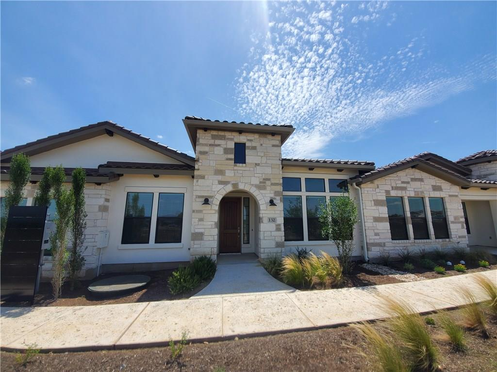 "Enjoy easy living in the first 55+ lock & leave resort style community in the beautiful Hill Country of Texas in Horseshoe Bay. Construction on the clubhouse and pool are underway! This town home features an open concept floor plan,white cabinets,wood look tile flooring, Bosch appliances w/gas cook top, granite counters in kitchen & baths. Sink in utility room. The master bedroom includes a large walk in closet with a private back patio. 2""faux wood blinds included. 1 Year Prepaid Tuscan Village HOA dues.Restrictions: Yes  Sprinkler Sys:Yes"