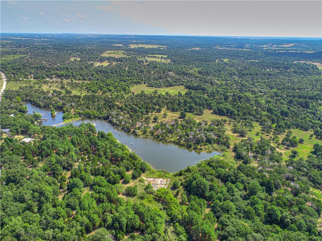 DEVELOPERS DREAM! 62acres PRE-PLOTTED residential lots ranging from .17-.86, average lot roughly .25 w/ designated roads already recorded w/county. Some over sized lots that can be subdivided further. Beautiful partially cleared land with gorgeous trees and lake running through property, equipped with spillway for flood prevention. Can develop or purchase for personal use. Electric, water and city sewer available Priced to sell! Bring your investor clients and developers! NO COVENANT OR DEED RESTRICTIONSRestrictions: Unknown