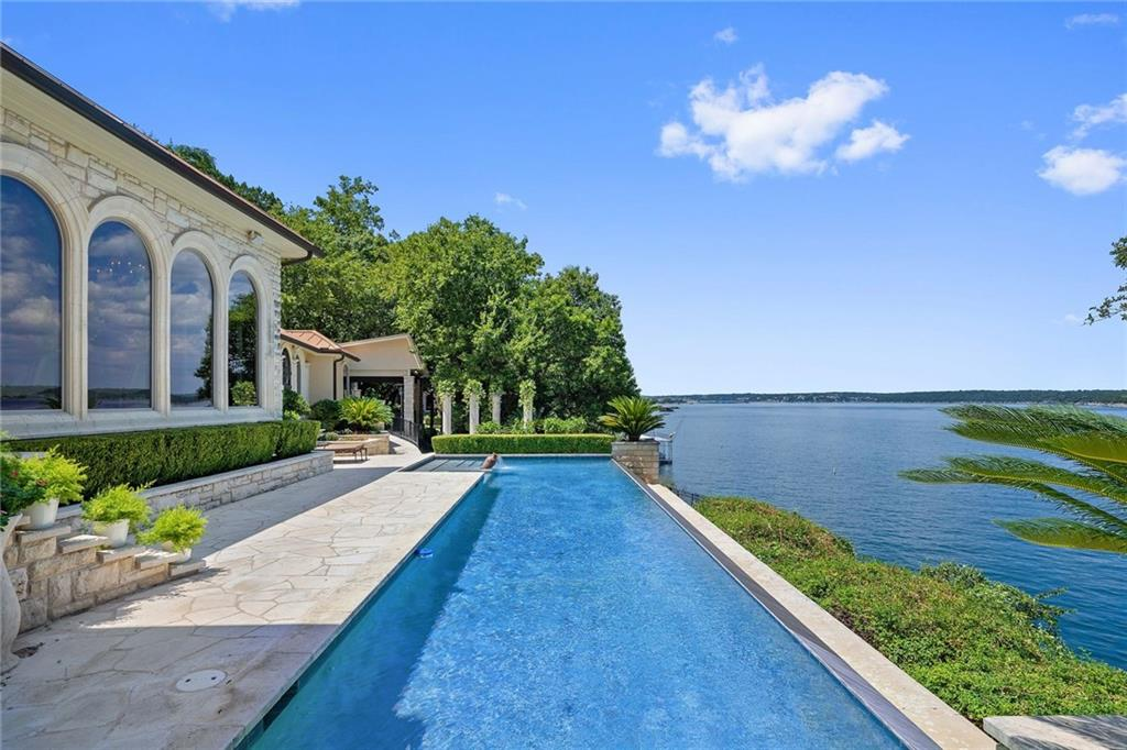 Rare opportunity to own 5.469 acres on the deep water of Lake Travis in a close-in location.  Extremely private with gated entrance. Property has 8 L.U.E.s in place with 3.5 currently in use. Fabulous wedding venue possibilities with formal gardens overlooking the lake.  Elegantly appointed residence with negative edge pool. Putting green, sport court, greenhouse, outdoor kitchen and caretaker's cottage on property.  Has not been on the market since seller purchased over 30 years ago. Don't miss it!Guest Accommodations: Yes Restrictions: Yes  Sprinkler Sys:Yes