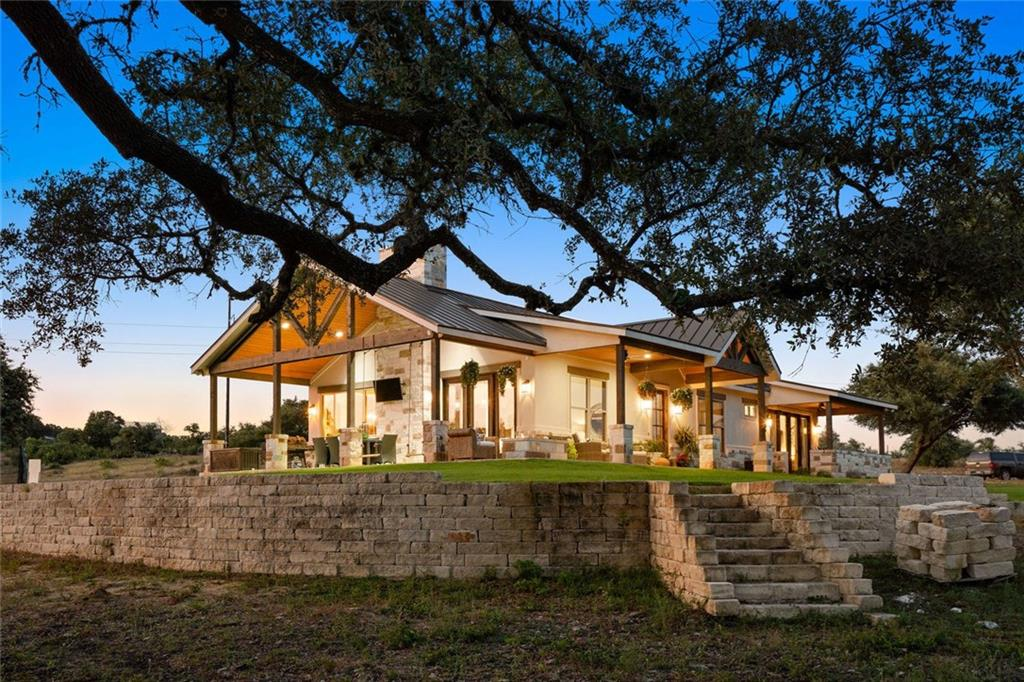 ** Owner Financing Available** Live, Work and Play on this unique 15 acre property zoned light commercial! Beautiful Hill Country home: 3 bed 2 bath concrete floors, open kitchen with large granite island. Fabulous covered outdoor living area with stone propane fireplace and TV; large master bedroom with private covered porch for enjoying morning coffee, walk-in shower. 1700 sq ft shop with 500' frontage on FM 32 guest House, pole barn, lighted arena, and pond. Ag exemption is in place. Wimberley SchoolsGuest Accommodations: Yes Restrictions: Yes  Sprinkler Sys:Yes
