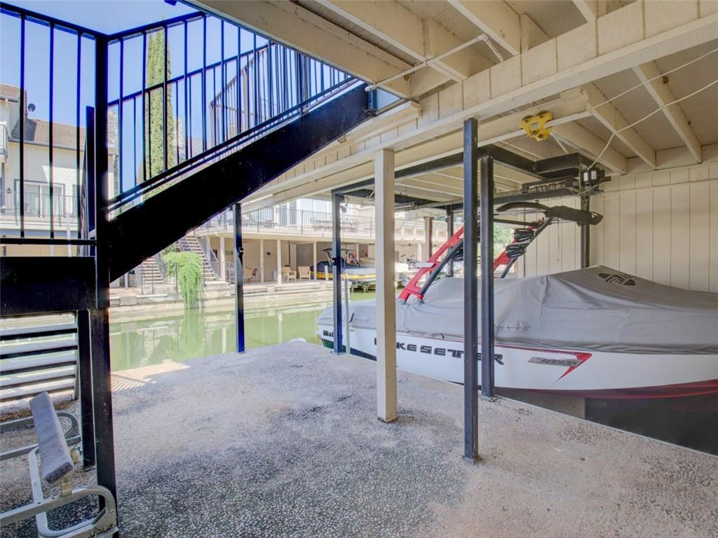 Rare price with private dock. Short-term vacation rentals allowed, grossing $24K in 2018. Lake LBJ Waterfront Town Home on a deep and wide canal just off the open water. Love the outdoor life with an over-sized patio off the main living, large shady patio at the water and a balcony off the master. Steel supported heavy duty boat slip with electric lift. Welcome inside to the open great room with living, kitchen and dining. Lovely fireplace with shiplap details. 3 large bedrooms are all en-suite.Restrictions: Yes