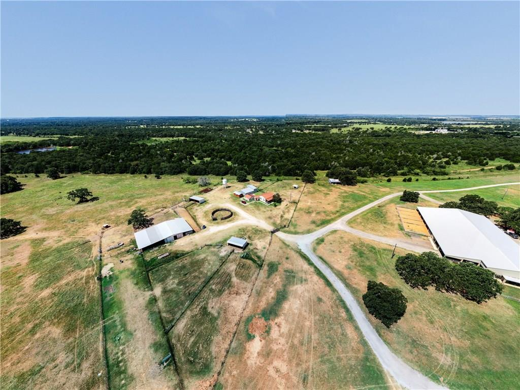 Beautiful Horse  and Cattle Ranch with 166 Ag Exempt acres, located at the corner of Hwy 290 E and SH 21. Original remodeled Ranch home from 1927, sit on the porch and see the amazing views, of ponds, horses, cattle ect. Large Covered riding arena with stables, tack room, plus office and living quarters. Outdoor riding arena, cattle pens, pole barns, round training pen and so much more.  Main access is from Sh 21 Gated Entrance.  But also access from 290 E.FEMA - Unknown Guest Accommodations: Yes Restrictions: Yes