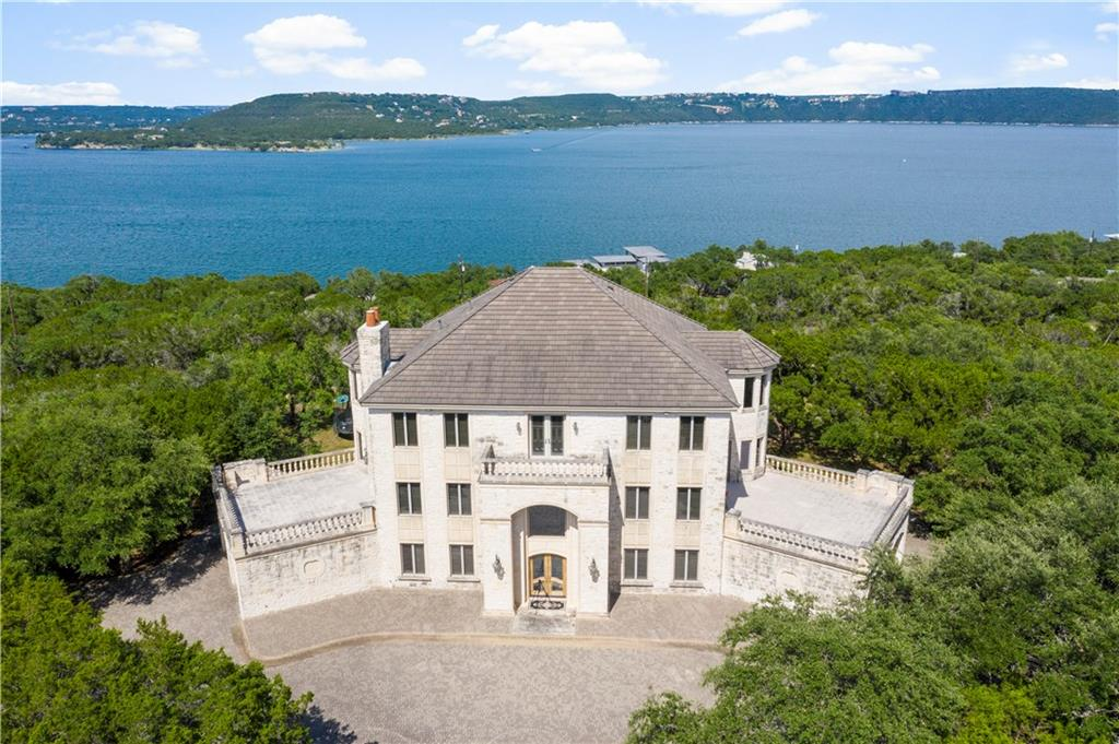 French Colonial Waterfront hilltop estate on 6.1 acres.  Panoramic views from Mansfield Dam to Starns Island and beyond.Guest Accommodations: Yes Restrictions: Yes  Sprinkler Sys:Yes