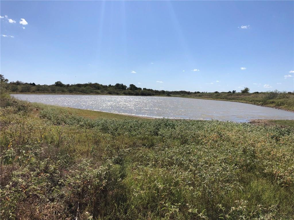 Close to Austin area. Part of a large game ranch subdivided into 17 tracts. All tracts restricted to site built homes only. Barndominiums are allowed. This tract has a 3,500 sq ft barn on a slab, plumbed with a bathroom. Large pond on property.  Partially high fenced now. Owner in process of finishing high fencing in the large area of the tract prior to closing (see survey in pics). Electricity on property & public water available. Up to 4 homes allowed on this tract. Owner financing offeredRestrictions: Yes