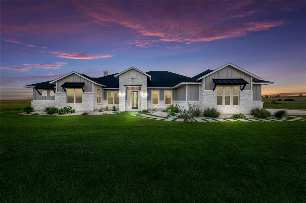Entertainer's dream! Waterfront acreage w/custom home equipped w/elegant full wall of glass sliding doors, that open to covered back porch. Take in the view of the 2 Acre stocked pond. Perfect horse property! The 21.68 acres of fully agriculture exempt land offers spectacular views & lush improved pastures. Fertile soil & recently planted trees. Private gated access to this tight knit farm & ranch community. Abundance of wildlife. Bird & bow hunting permitted. Barns, Arena, & Guest Casita permitted.EES Features: See Attachment Restrictions: Yes  Sprinkler Sys:Yes