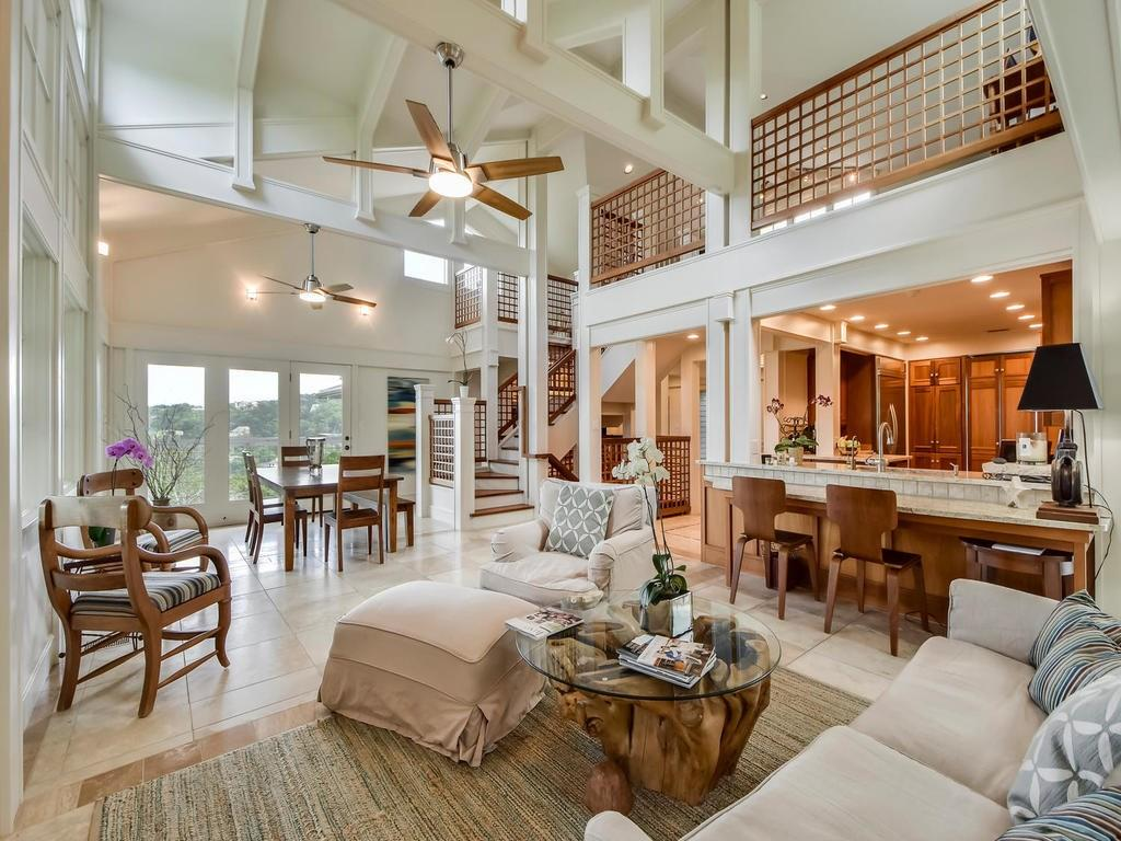 This craftsman-style contemporary sits at the end of a private drive minutes from downtown with views into the hills. The home boasts an open floor plan with tall ceilings and windows to take in the views. The master suite and two additional bedrooms are on the main level. There is a gorgeous loft-style office. Lower level game room with another bedroom/bath. Detached space perfect for studio/gym. Total privacy but a short commute to downtown. Exemplary Eanes ISD.