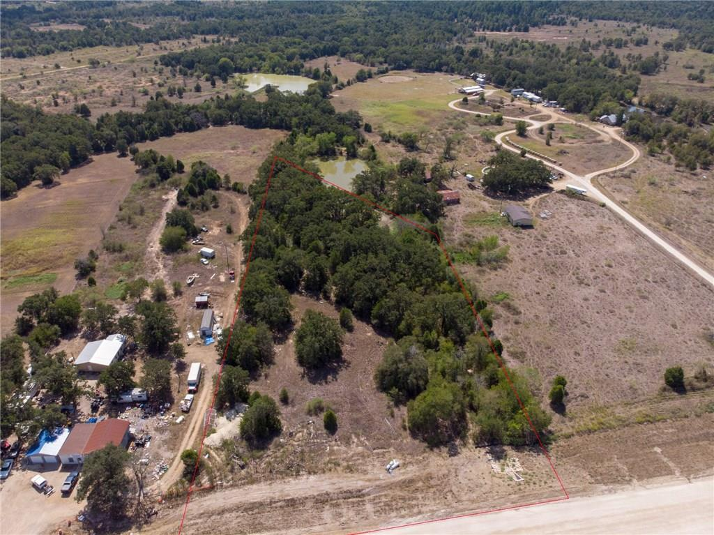 Commercial lot with +/- 285 ft. of frontage on US HWY 290. No deed restrictions, no zoning. Survey available. Highway is being expanded and improved in front of the property. Lot dimensions are estimated, please see existing survey for more accurate dimensions.
