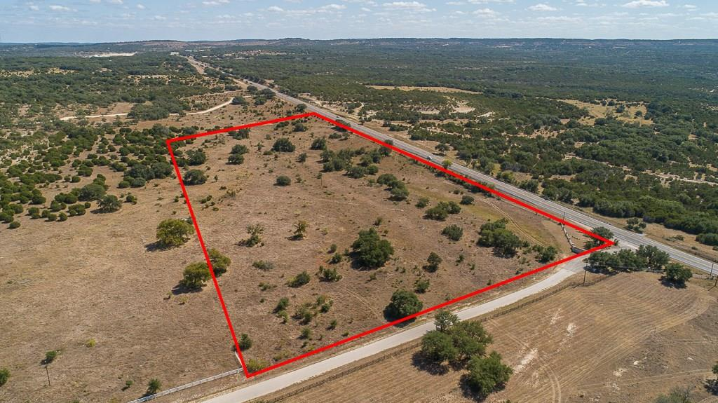 Residential or Commercial tract in the Tierra Manana Subdivision with some restrictions. Could also be used for combination of residential and commercial. Agricultural valuation under wildlife management keeps taxes low. Over 1200 ft. frontage on Hwy 290 with best potential access on the eastern side of tract. Tract also fronts on Esperanza Trail inside Subdivision. Great views and a scattering of large oaks. Seasonal draw. Convenient to Austin, San Antonio and Hill Country destinations.FEMA - Unknown Restrictions: Yes