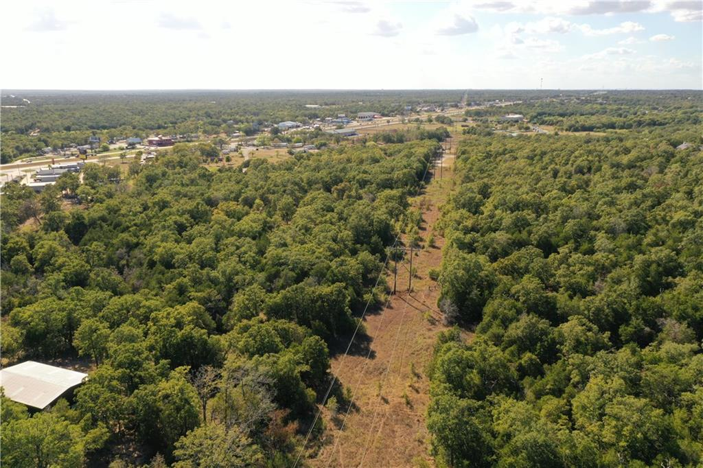 25 acres of property in close proximity to TX 71. Only 5 acres of this land is restricted and the remaining is unrestricted. Property backs to Bastrop's prestigious neighborhood The Colony and also borders The Woodlands. Come build your dream home and have plenty of land to play on all while being close to Bastrop and Austin. Owner Financing Available.