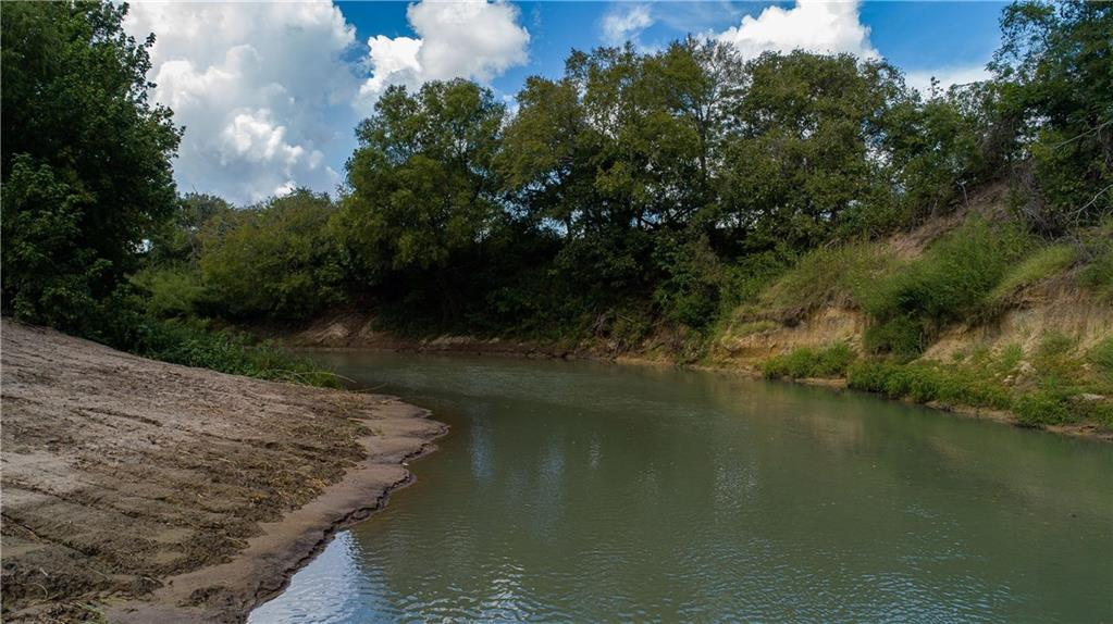 CENTRAL TEXAS LIVE WATER HORSE RANCH The San Marcos River Ranch is the ultimate live water ranch within an hour & fifteen minutes of Austin & San Antonio, TX and conveniently located approximately 15 minutes from Interstate 10 and US Highway 183 travel routes. This natural beauty presents a park like setting along more than one mile of San Marcos River frontage and retains more than thirty acres of thriving and majestic Pecan tree filled river bottom terrain. ~5465 FT of San Marcos River Frontage.Guest Accommodations: Yes