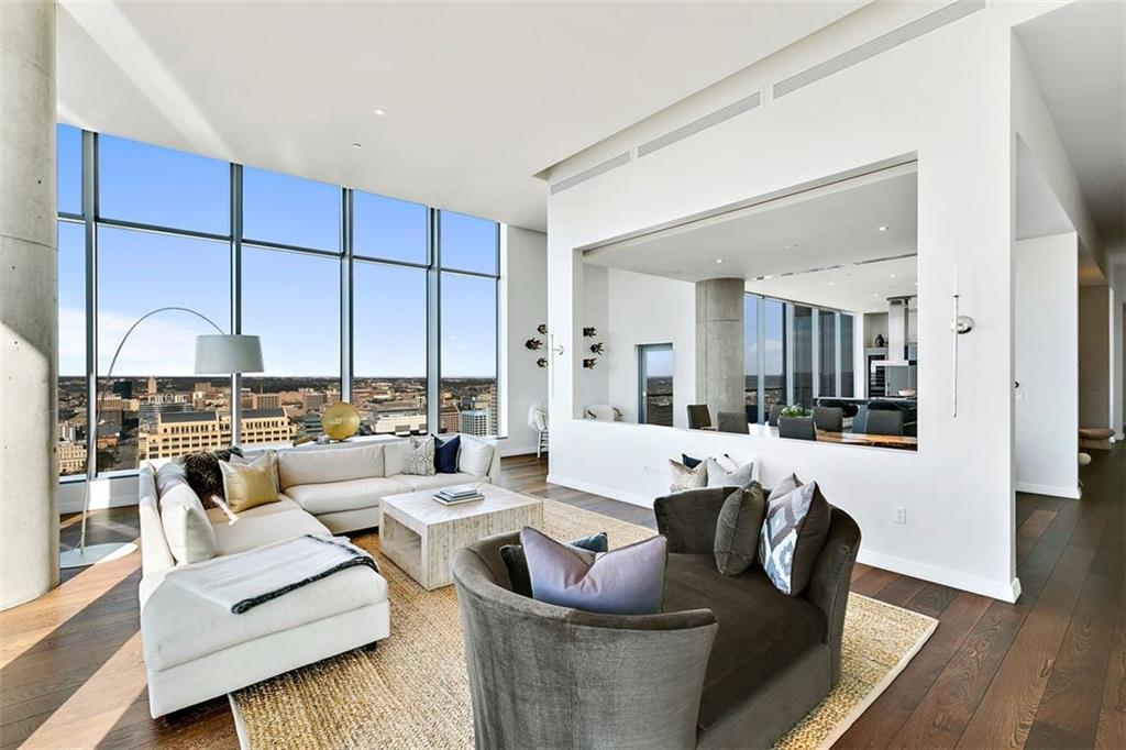 Panoramic City views amaze from this W Residences Penthouse on the NW corner of the 36th floor. Sleek architecture, clean lines, abundant natural light, soaring ceilings & hardwood floors. Fully-equipped chef's kitchen open to dining and living. Secluded master suite with large closet & soaking tub overlooking the city. 2 secondary en-suite bedrooms, large utility room, multiple balconies and private 3-car garage. Full access to W Resident and hotel pool, gym, steam room, yoga and Away Spa.Restrictions: Yes  Sprinkler Sys:Yes