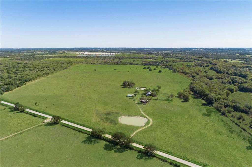Beautiful 73.8-Acre Ranch in Flatonia!  Large cattle/hay barn, cattle pens, 3 ponds, and a well.  Shop with lights, recently painted roof, interior & exterior, 100 amp electrical outlet for RV, holding tank for RV waste water outside of shop underground, eco-foil in ceiling to block excessive heat.  Underground utility lines to all buildings for electricity, water, CAT 6 cable X2 for LAN network internet access.  Current use: hay production & cattle grazing.Restrictions: Unknown