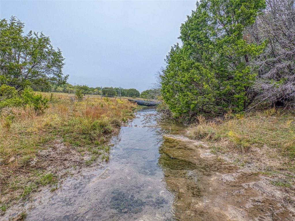 The Kinchelo Creek Ranch is located on CR 2109, around 20 minutes NW of Lampasas.  There is over 200 feet of elevation change, ranging from 1,440 ft. to 1,220 ft.  The hilltops provide big time views  almost a 360 degree panoramic view.  Clear flowing Kinchelo Creek meanders through the property and there are small waterfalls. Addition to the creeks there are four small ponds. If you are looking for a great hunting/recreation ranch, a place to build a home, or a legacy ranch to be enjoyed by your family.