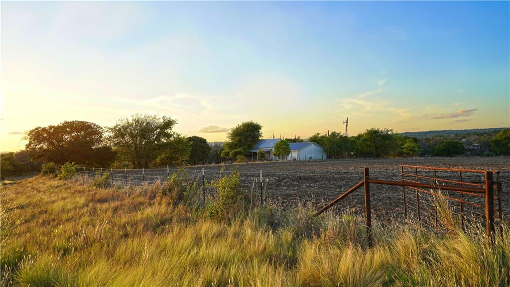 Unrestricted 25 acre homestead 15 mins from Fredericksburg & less than 5 miles off 290. This charming farm has 13 ac tillable field w/productive soils, 100 GPM well, barn w/sheds, & small stock tank w/water. Original 1224 sqft 2/2 house w/attached garage would make great tasting room or wknd getaway. Property sits on western slope of a range of hills & offers nice views to W & NW. A stand of mixed hardwoods wraps around property on two sides. Partial clearing has been done. Whitetail and Axis on property.Restrictions: Unknown