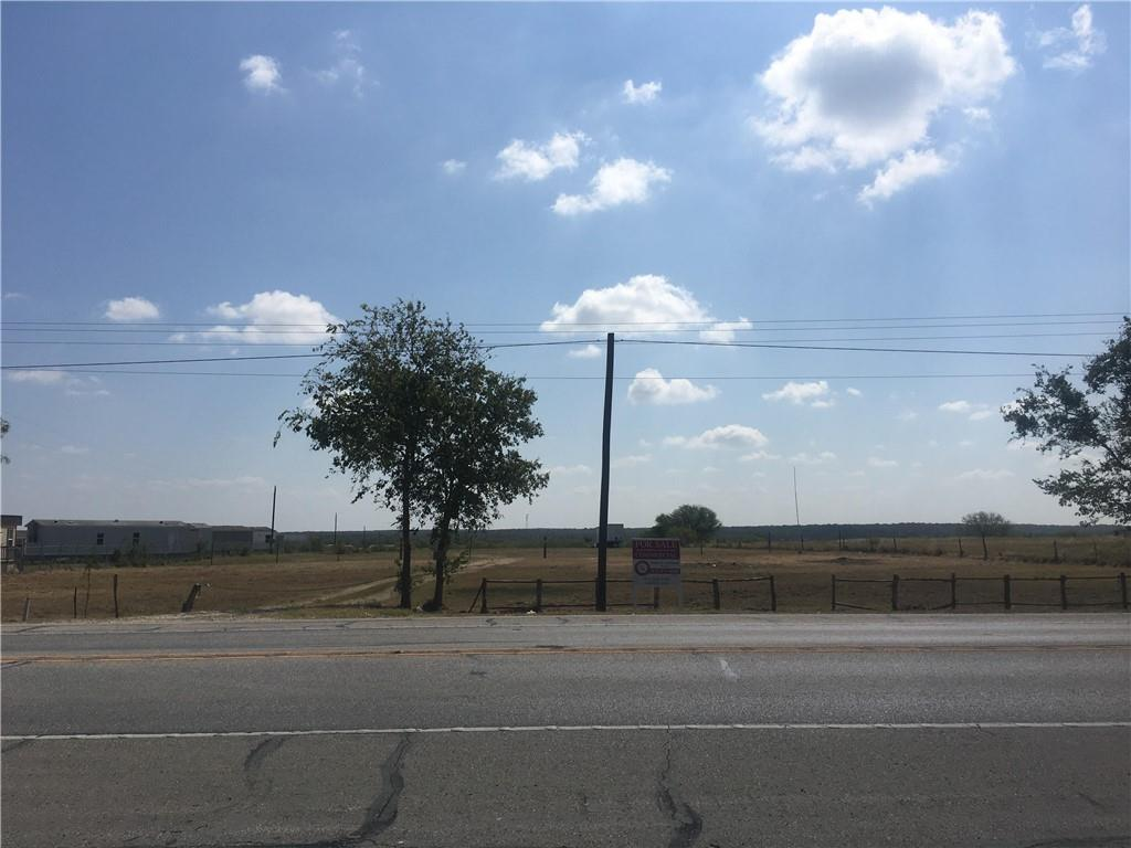 Open and level 5 acre track with tons of possibilities.  Could be used for Conv. Store or maybe parking lot for COTA events.  Approx 10 min trip to Circuit Of the Americas which is on FM 812 toward Austin.  200 Ft of Hwy 21 frontage.