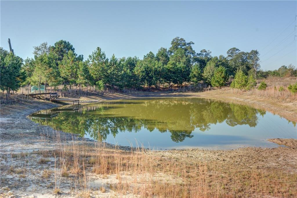 Great opportunity to own a large acre tract within 10 minutes of downtown Bastrop and within 5 minutes of Highway 21/290 interchange. This property offers endless possibilities with creeks, ponds, pine trees, oak trees, cleared areas, trails, and abundant of wildlife. Very private setting with country cabin and 2 car garage. This ranch would make a great weekend retreat/recreational or full time operation with plenty of sites for a custom home/barndominium. This is a must see!! 86+/- Acres.Restrictions: Unknown