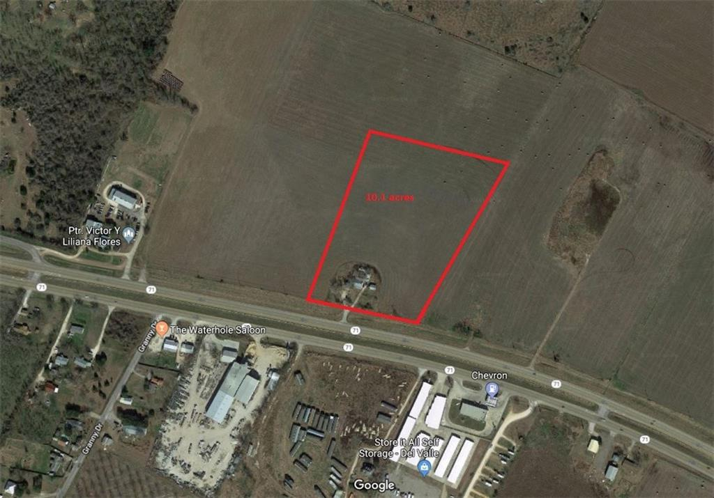 Go Drive By - Do Not Disturb Tenant in residence. 10.1 acres in rectangle shape. Fantastic for development.Flat, no topography. Bluebonnet Electric and Garfield Water. Septic system currently in use for residence. In City of Austin ETJ. No flood plain. Over 490' of Hwy 71 North Frontage.