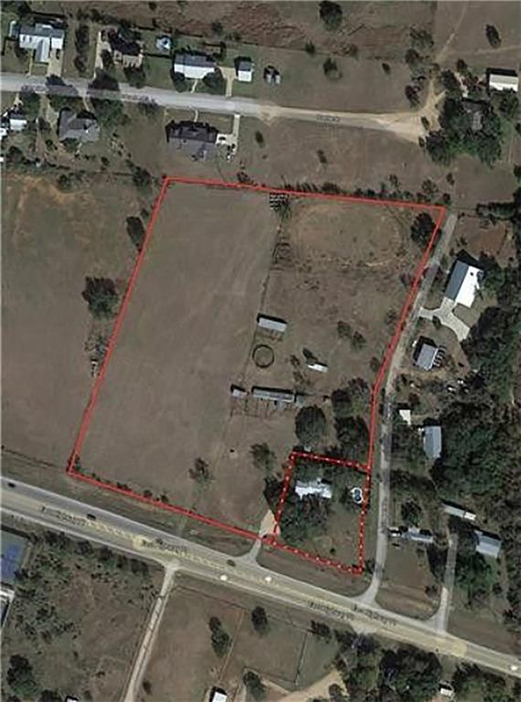 Restrictions: Yes Unzoned lot with commercial potential.  Fairly level with excellent visibility.  House is livable but not considered to have much value.  The property does have a recently built pool that could perhaps be repurposed as an amenity for a multi-family development.  Potential uses include retail, industrial and multi-family. Listing agent working on getting information regarding potential sewer line extension.  Will show interior of house only with accepted offer.  NOT IN CITY LIMITS.