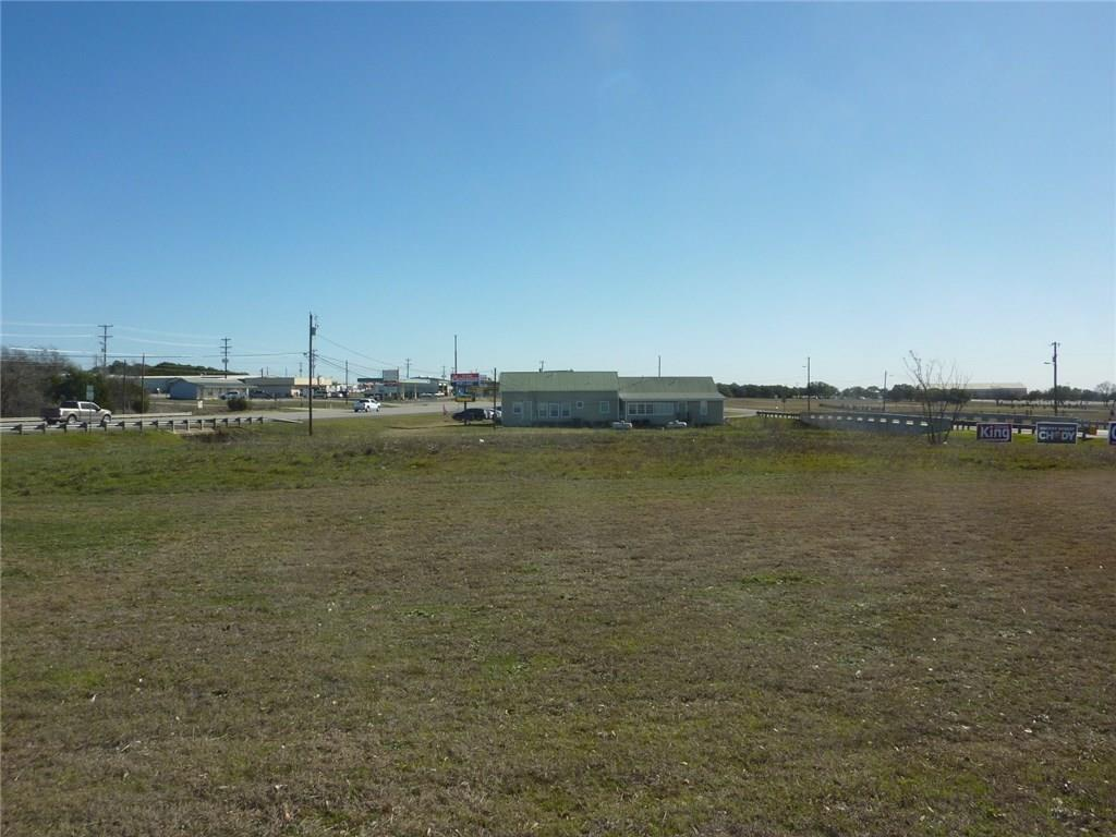 Come join the modern day land rush in Liberty Hill. Hundreds of new homes being build and LH needs lots of different services!  This is probably the Most Visible Commercial Lot with best accessibility in Liberty Hill! Site for fast food, office/strip center, C store, car wash, w/ entrances available off Hwy 29 AND Loop 332 (final approval from TXDOT & City) Traffic is in excess of 25,000 vehicles (Hwy 29) & 3,100 (Loop 332).  City sewer & water available (City to determine capacity)