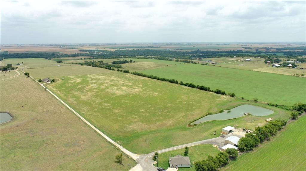 111+/- unrestricted acres in Hutto ETJ with beautiful Brushy Creek frontage. Residential development potential in a rapidly growing area. A fantastic buy & hold investment property that you enjoy hunting, fishing, farming and ranching while property continues to appreciate. Income potential from leasing homes, hay production and grazing & hunting lease. Improvements include two custom homes, barn and equipment shed. Each home is a 3 bd and 2 bath and 1822 sf & 1284 sf. Fenced for cattle and is currently ag exempt. Has fertile black soil with huge scattered pecan trees, level to sloping topo. Also has a wet weather creek and 3 stock ponds. Water meter by Manville and power provided by Oncor. Property is accessed by a gravel easement road. This property consists of four parcels in Travis and Williamson Counties. An adjacent 50+/- ac tract is available with home that has frontage on paved road Melber Ln.