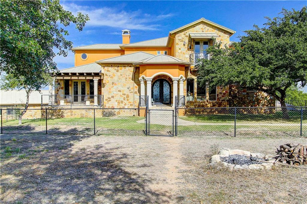 Stunning Spanish-inspired custom home. Spectacular panoramic Lake Travis and hill country views. Every bedroom has bathroom and walk-in closet. Impressive executive office.  Media room. A game (billiards) room, a second sound proofed media room and a gym/multi-purpose room. Huge nine-car garage. An indoor two lane junior Olympic lap pool.  A six-foot concrete wall along the front and sides. A 38,000-gallon rainwater collection system. A 40 GPM well. 13 zoned sprinkler system.Restrictions: Yes  Sprinkler Sys:Yes