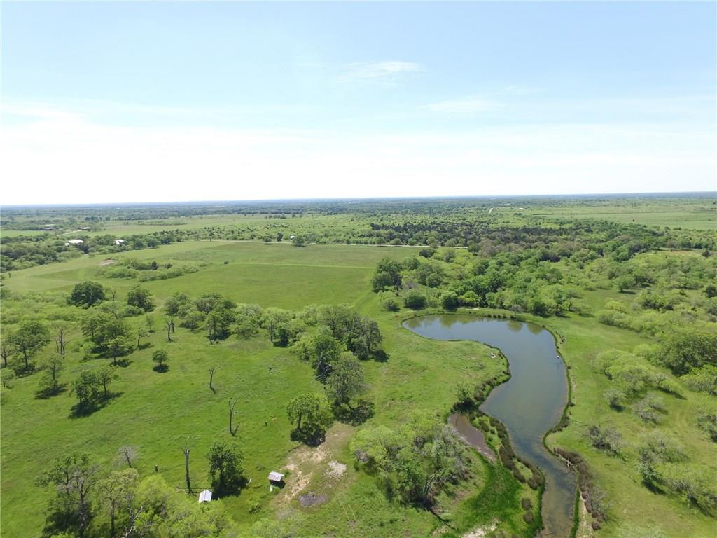 High fenced property with 2 ponds, seasonal creek, pecan, post oaks, mesquites. An old water well that was capped & Fayette Water Supply Corp water available at road. 18 acres are cleared. The big pond has a feeder & is stocked with catfish, bass & perch. This ranch fronts two roads with all roads approaching the ranch being paved except Robbins Cemetery. Soil is mostly Sandy Loam with some Clay Loam. Some flood plain, Cattle pens & catch pen on the property. Minerals may be negotiable with the right offer.